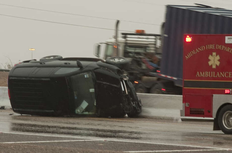 Midland units respond to multiple calls of accidents Thursday morning on Loop 250 as well as multiple accidents along I-20 as freezing rain coated roadways. Tim Fischer\Reporter-Telegram Photo: Tim Fischer