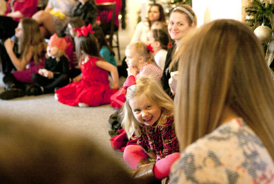 Three-year-old Presley Rodgers reacts as members of Midland Festival Ballet put on a Nutcracker ballet demonstration during the Christmas at the Mansion open house event at the Museum of the Southwest on Saturday. The open house event also featured a mother-daughter brunch. James Durbin/Reporter-Telegram Photo: JAMES DURBIN