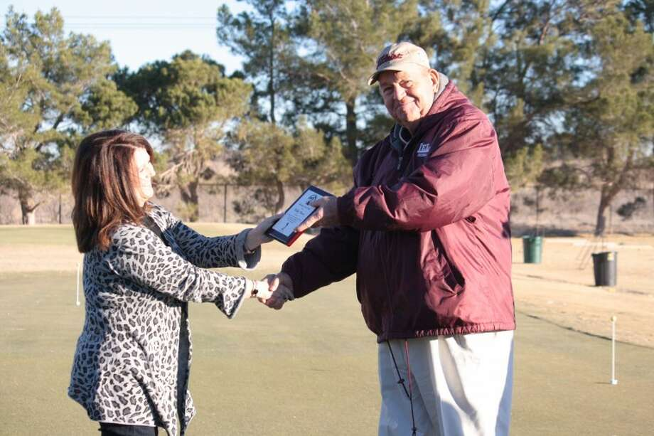 In this 2012 photo, former Lee golf coach Bobby Dunn is presented with the 30-year Lee Rebel Golf Service Award on Saturday prior to the final round of the Jack Ratcliff Tall City Invitational at Ranchland Hills Golf Club. Dunn retired from the position as boys golf coach at Lee in 2011.