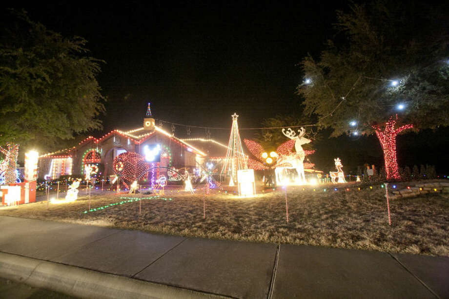 Grasslands homeowner Ricky Thames incorporates an extensive light and audio display into his Christmas decorations and accepts donations for a local soup kitchen from people who drive by. Image taken Dec. 12, 2013. James Durbin/Reporter-Telegram Photo: JAMES DURBIN