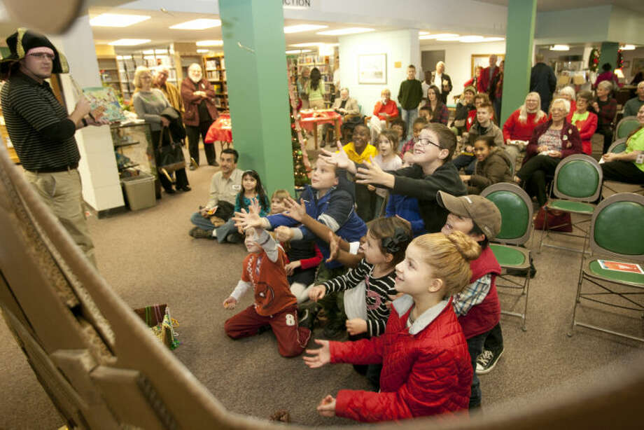 "Children look on during an interactive presentation of ""A Pirates 12 Days of Christmas"" during an open house event at the Downtown Library on Thursday. James Durbin/Reporter-Telegram Photo: JAMES DURBIN"