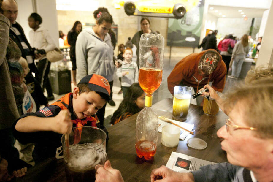 Mikael Anderson, age 6, creates a vortex in a pitcher during Space Escape Family Science Night on Thursday at the Petroleum Museum. James Durbin/Reporter-Telegram Photo: JAMES DURBIN