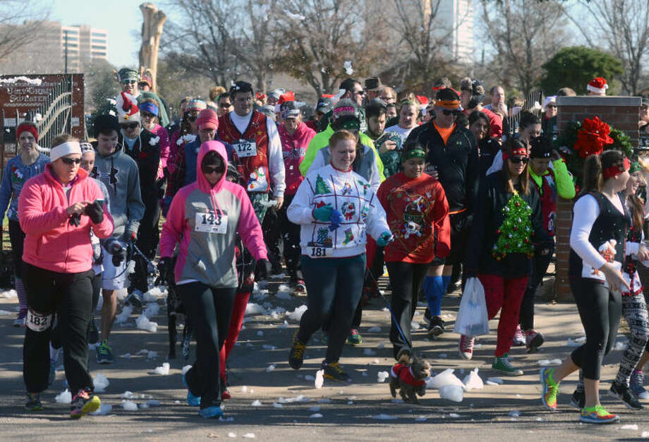Ugly Sweater 5K Run participants start the race on Saturday at Museum of the Southwest. James Durbin/Reporter-Telegram Photo: JAMES DURBIN