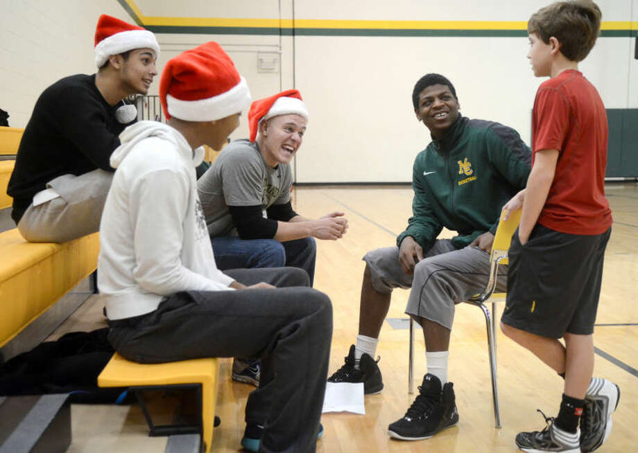 Sam Hullender hangs out with Midland College basketball players during a Christmas basketball camp Saturday at Midland College. James Durbin/Reporter-Telegram Photo: JAMES DURBIN
