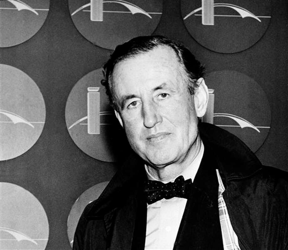 FILE - This 1962 file photo shows Ian Lancaster Fleming, the best-selling British author and creator of a fiction character known as secret agent, James Bond. British doctors who carefully read Ian Fleming's series of James Bond novels say the celebrated spy regularly drank more than four times the recommended limit of alcohol per week. Their research was published in the light-hearted Christmas edition of the journal BMJ on Thursday Dec. 12, 2013. (AP Photo/File) Photo: STF / AP