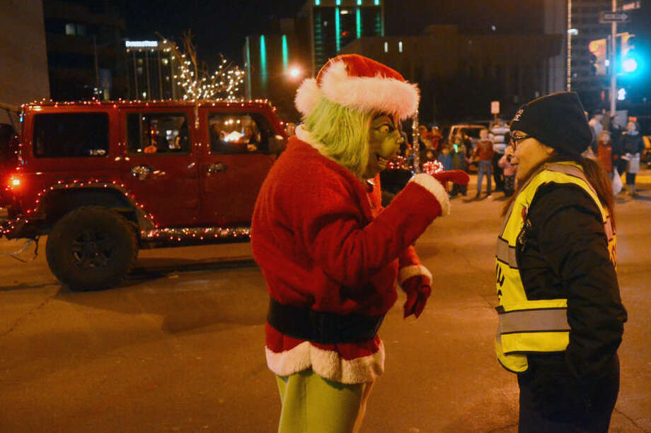 Midland Community Service Officer Liz Thornton has a conversation with the Grince during the Parade of Lights on Saturday. James Durbin/Reporter-Telegram Photo: JAMES DURBIN