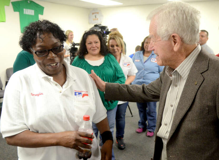 MISD employees line up to thank Jim Henry of the Henry Foundation for a $1 million grant allocated to assist the support staff at MISD with housing-related costs during a reception Thursday at the School Plant Services Office. James Durbin/Reporter-Telegram Photo: JAMES DURBIN