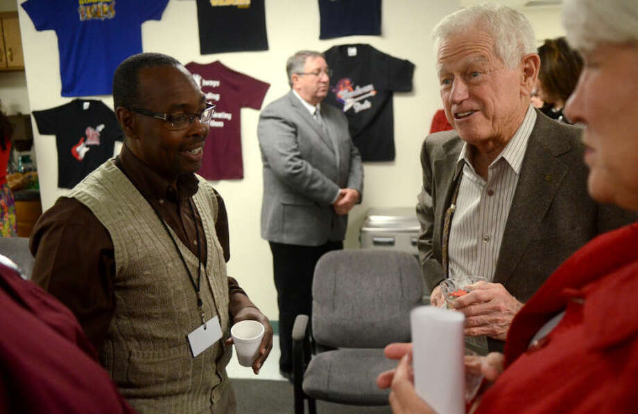 Jim Henry talks with MISD employees during a reception thanking the Henry Foundation for a $1 million grant allocated to assist the support staff at MISD with housing-related costs Thursday at the School Plant Services Office. James Durbin/Reporter-Telegram Photo: JAMES DURBIN