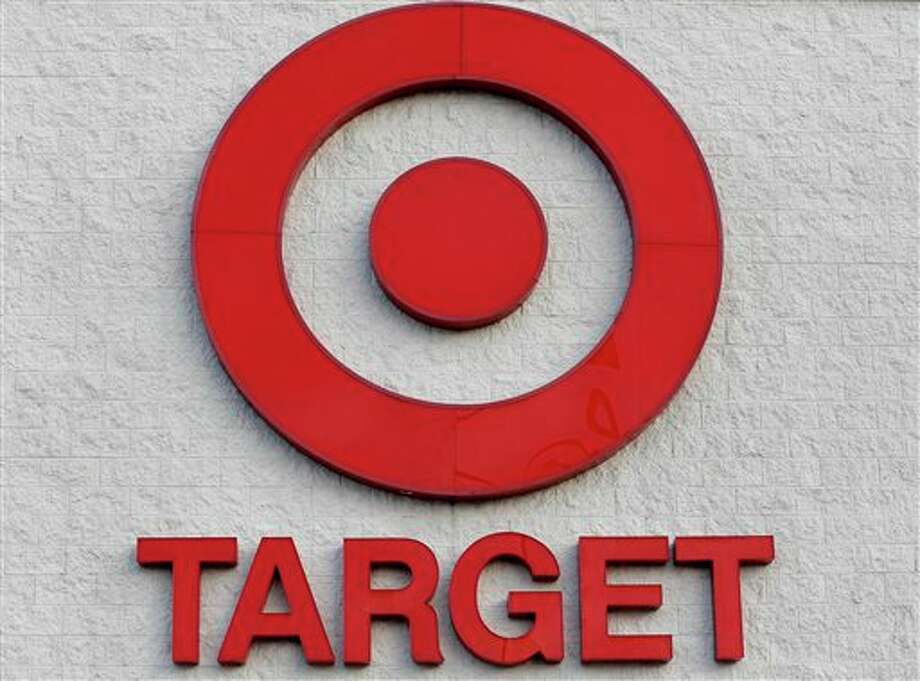 This Thursday, Dec. 19, 2013 photo shows a Target retail chain logo on the exterior of a Target store in Watertown, Mass. Target says that about 40 million credit and debit card accounts may have been affected by a data breach that occurred just as the holiday shopping season shifted into high gear. (AP Photo/Steven Senne) Photo: Steven Senne / AP