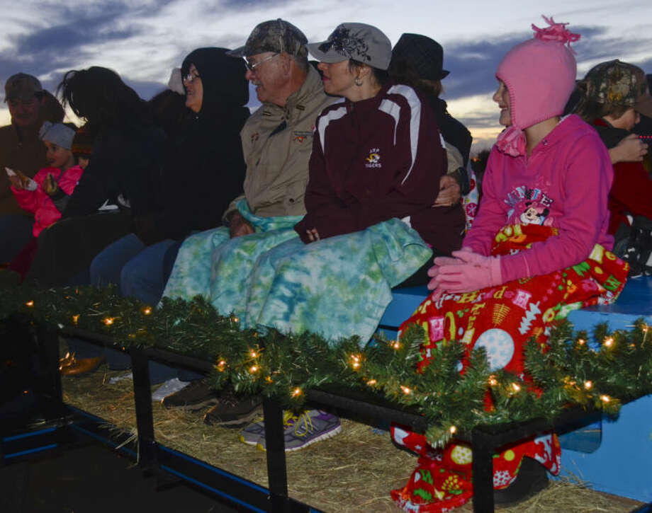 Families climb on a trailer for a hayride tour of Grasslands light displays Saturday evening at Stonegate Fellowship's Christmastime in the City. Tim Fischer\Reporter-Telegram Photo: Tim Fischer