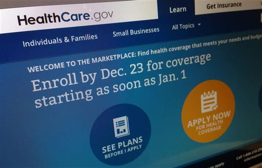 FILE - This Dec. 20, 2013, file image shows part of the HealthCare.gov website in Washington, that notes to enroll by Dec. 23 for coverage starting as soon as Jan. 1, 2014. Anticipating heavy traffic on the government's health care website, the Obama administration effectively extended Monday's deadline for signing up for insurance by a day, giving people in 36 states more time to select a plan. (AP Photo/Jon Elswick, File) Photo: Jon Elswick / AP