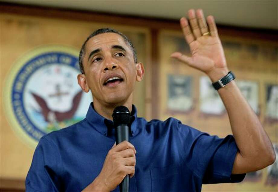 President Barack Obama speaks to members of the military and their families in Anderson Hall at Marine Corps Base Hawaii, Wednesday, Dec. 25, 2013, in Kaneohe Bay, Hawaii. The first family is in Hawaii for their annual holiday vacation. (AP Photo/Carolyn Kaster) Photo: Carolyn Kaster / AP