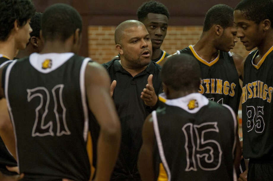 Alief Hastings head coach, Darrell Collins, talks with his players during a timeout Friday in a matchup against LHS in the Byron Johnston Holiday Classic. Tim Fischer\Reporter-Telegram Photo: Tim Fischer