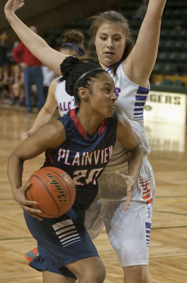 Plainview's Taivia Hearn drives the lane and is fouled by Eastlake's Heather Crittenden Saturday in the girls championship game of the Bryon Johnston Holiday Classic in Midland. Tim Fischer\Reporter-Telegram Photo: Tim Fischer
