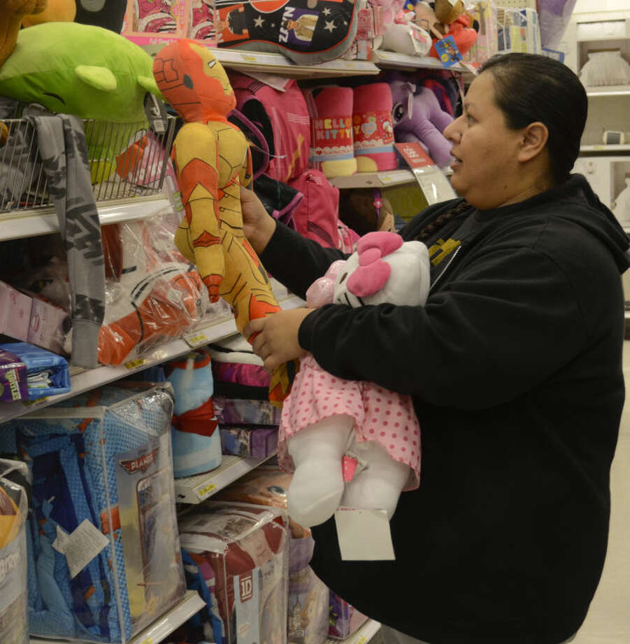 Rebecca McFadden looks at plush dolls for her children Friday morning during a special Friends of Hope shopping spree at Target through Casa de Amigos. Tim Fischer\Reporter-Telegram Photo: Tim Fischer