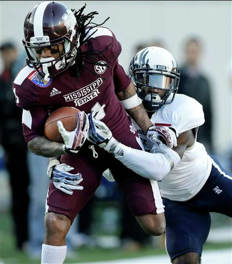 Mississippi State wide receiver Jameon Lewis, left, is brought down at the 2-yard line by Rice safety Julius White, right, in the second quarter of the Liberty Bowl NCAA college football game on Tuesday, Dec. 31, 2013, in Memphis, Tenn. Lewis gained 35 yards on the play. (AP Photo/Mark Humphrey) Photo: Mark Humphrey / AP