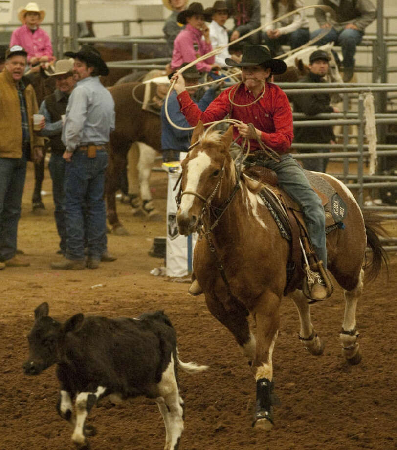 Austin Madry and his horse chase after a calf Monday during the Tall City New Year's Calf Roping Blowout at the Horseshoe Arena. Tim Fischer\Reporter-Telegram Photo: Tim Fischer
