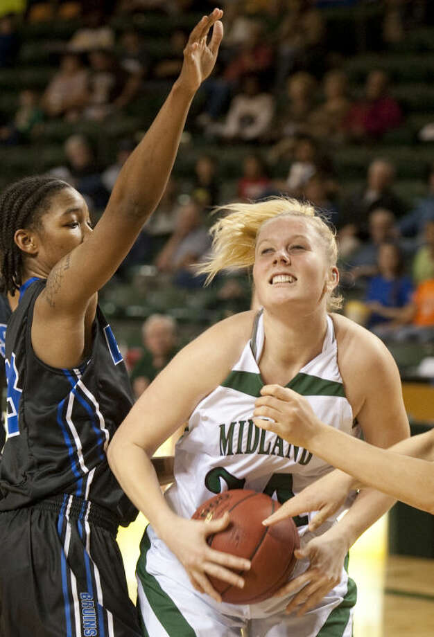 Midland College's Catherine Kruschke tries to put a shot up as SLC CC's Tanesha Daniels defends Thursday night at the WNIT basketball tournament at Chaparral Center. Tim Fischer\Reporter-Telegram Photo: Tim Fischer