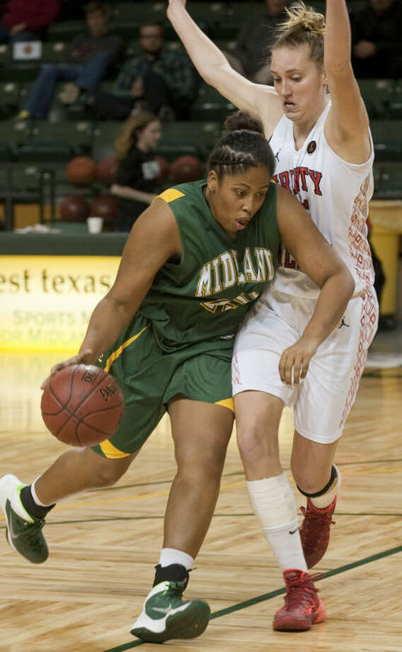 Midland College's Diamalises Rivera tries to drive the lane as Trinity Valley's Julianne Anchling defends Friday night at the WNIT basketball tournament at Chaparral Center. Tim Fischer\Reporter-Telegram Photo: Tim Fischer