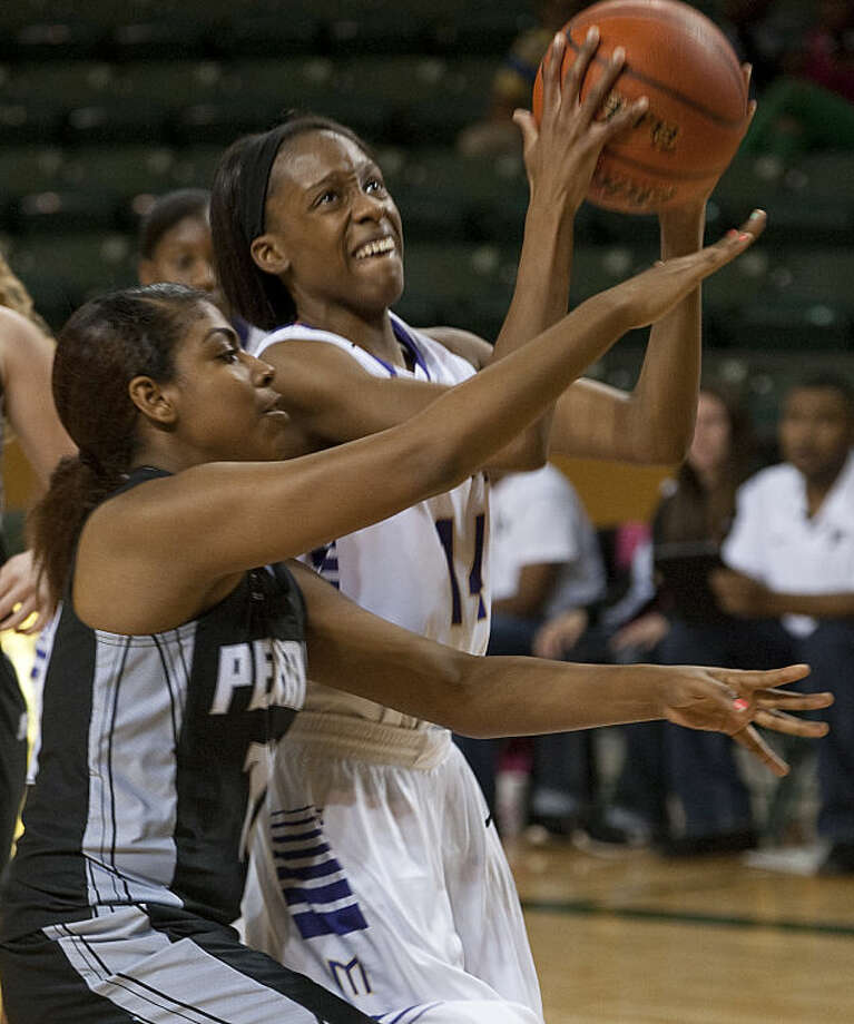 Midland High's Alexis Washington puts up a shot as Permian's Ke'Avionni Ramzy defends Friday evening at the Byron Johnston Holiday Classic tournament. Tim Fischer\Reporter-Telegram Photo: Tim Fischer