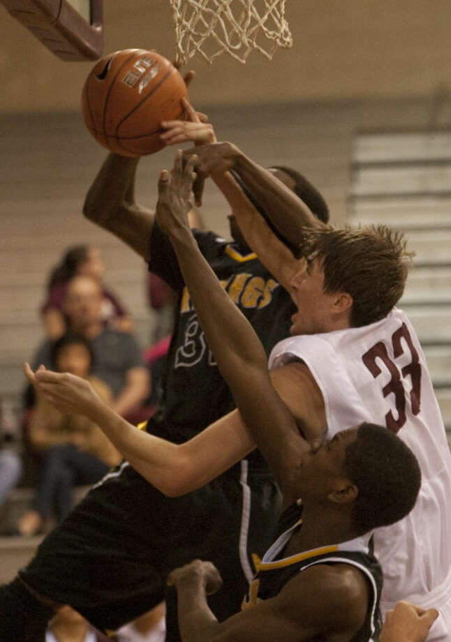 Lee's Jordan Williams battles for a rebound with Alief Hastings' Tobenna Okezie and Ejike Okocha-Ojeah Friday during the Byron Johnston Holiday Classic tournament. Tim Fischer\Reporter-Telegram Photo: Tim Fischer