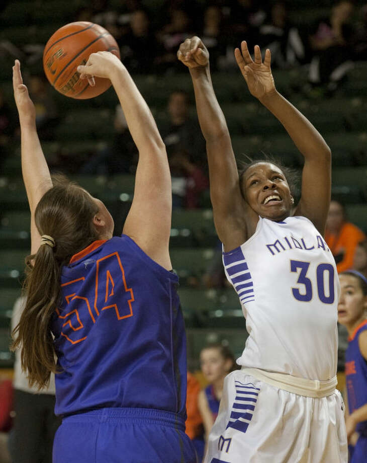 EP Eastlake's Heather Crittenden blocks the shot as Midland High's Desare' Allen drives the lane Thursday during the Byron Johnston Holiday Classic basketball tournament. Tim Fischer\Reporter-Telegram Photo: Tim Fischer