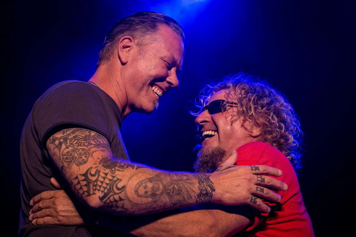 James Hetfield and Sammy Hagar embrace on stage at the Acoustic 4 A Cure benefit concert at the Fillmore Theater on Thursday, May 15, 2014 in San Francisco, Calif.