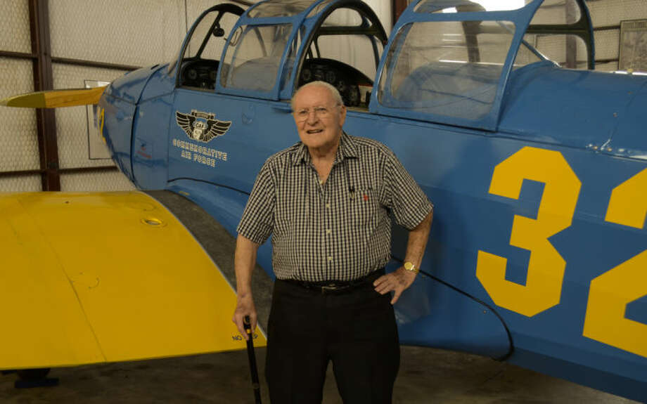 Robert Bell, WWII aviation veteran, stands next to a 1941 Fairchild PT-26, an identical plane to the PT-19 he flew in WWII except his did not have the added canopy. Tim Fischer\Reporter-Telegram Photo: Tim Fischer