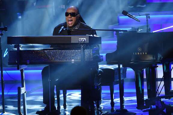 "HOLD FOR STORY FILE -  In this Feb. 10, 2015 file photo, Stevie Wonder performs  at ""Stevie Wonder: Songs in the Key of Life - An All-Star Grammy Salute,"" at the Nokia Theatre L.A. Live in Los Angeles. More than 7,000 athletes from more than 175 countries are in Los Angeles and ready to hit golf balls and tennis balls, kick soccer balls, swim laps, skate, run a triathlon and lift weights at the 2015 Special Olympics World Games. The athletes, each with intellectual disabilities, will be honored and entertained Saturday, July 25, 2015, at a glittering three-hour opening ceremony that will feature a welcome from first lady Michelle Obama and a cast of celebrities and former Olympic champions, as well as performances by Wonder, Avril Lavigne and others. (Photo by Chris Pizzello/Invision/AP, File)"