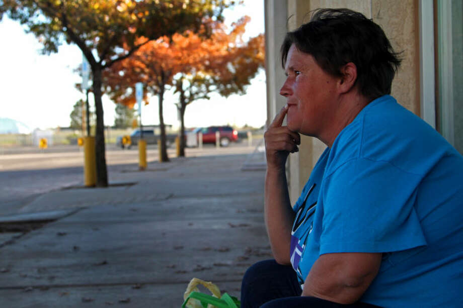 Homeless woman Tracy Evans looks across the downtown Midland Public Library on Nov. 21, 2013 as she finishes a cigarette. Tyler White/Reporter-Telegram Photo: Tyler White