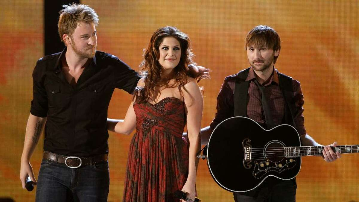 From left, Charles Kelley, Hillary Scott, and Dave Haywood, of the band Lady Antebellum, perform at the 45th Annual Academy of Country Music Awards in Las Vegas on Sunday, April 18, 2010. (AP Photo/Matt Sayles)