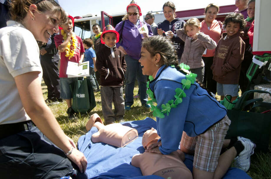 In this April 2013 file photo, Permian Basin CPR Instructor and Midland College adjunct clinical instructor Shirlinda Savahl shows 9-year-old Faviola Ojeda how to do chest compressions at the See MC community event. James Durbin/Reporter-Telegram Photo: JAMES DURBIN