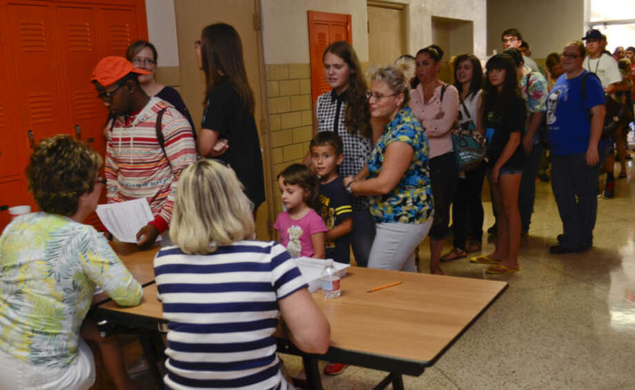 Midland High students wait to sign up for parking, id's, yearbook and other school related things during Dawg Days Tuesday at MHS. Tim Fischer\Reporter-Telegram Photo: Tim Fischer