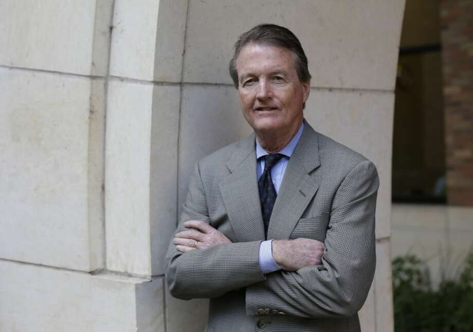 In this Thursday, Nov. 29, 2012 file photo, University of Texas president Bill Powers poses for a photo at the University of Texas, in Austin, Texas.AP Photo/Eric Gay
