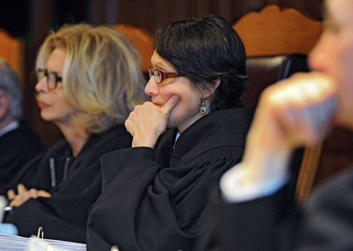 Janet DiFiore, Chief Judge of the Court of Appeals, left, and Jenny Rivera, associate judge of the Court of Appeals, listen to lawyers in a 2016 hearing. Last week, Rivera was the only justice on the state's top court to vote to reverse the conviction of a killer who was convicted by a jury that included a juror who said during jury selection that he'd