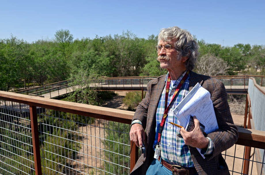 Midland Reporter-Telegram writer Ed Todd stands at the top of the I-20 Wildlife Preserve hawk tower overlooking part of the facility