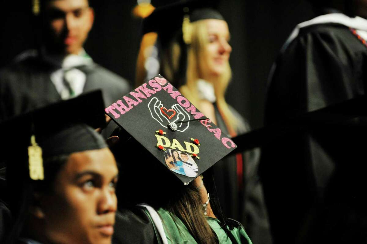 Graduates make their way up onto the stage to receive their diploma during Siena College commencement at the Times Union Center on Sunday, May 10, 2015, in Albany, N.Y. (Paul Buckowski / Times Union)