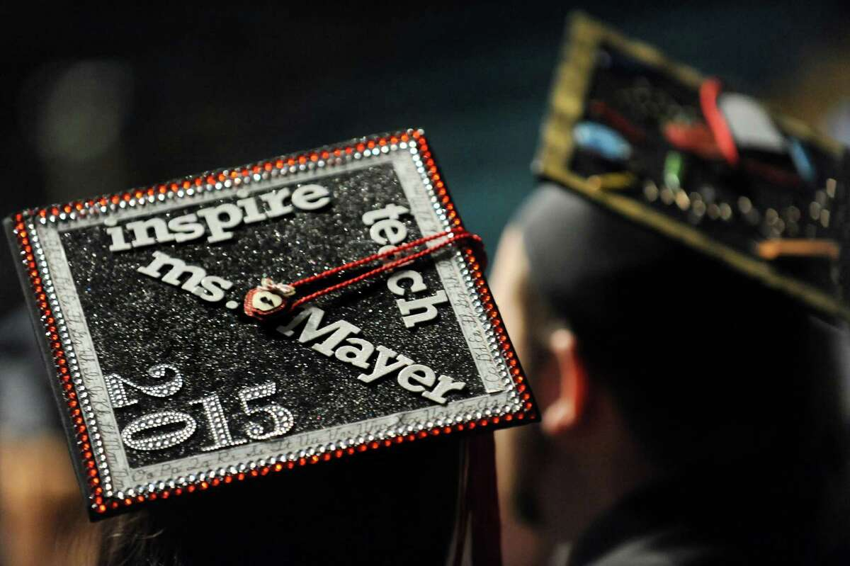 SUNY Adirondack graduates wear decorated mortar boards during commencement exercises on Thursday, May 14, 2015, at Glens Falls Civic Center in Glens Falls, N.Y. (Cindy Schultz / Times Union)