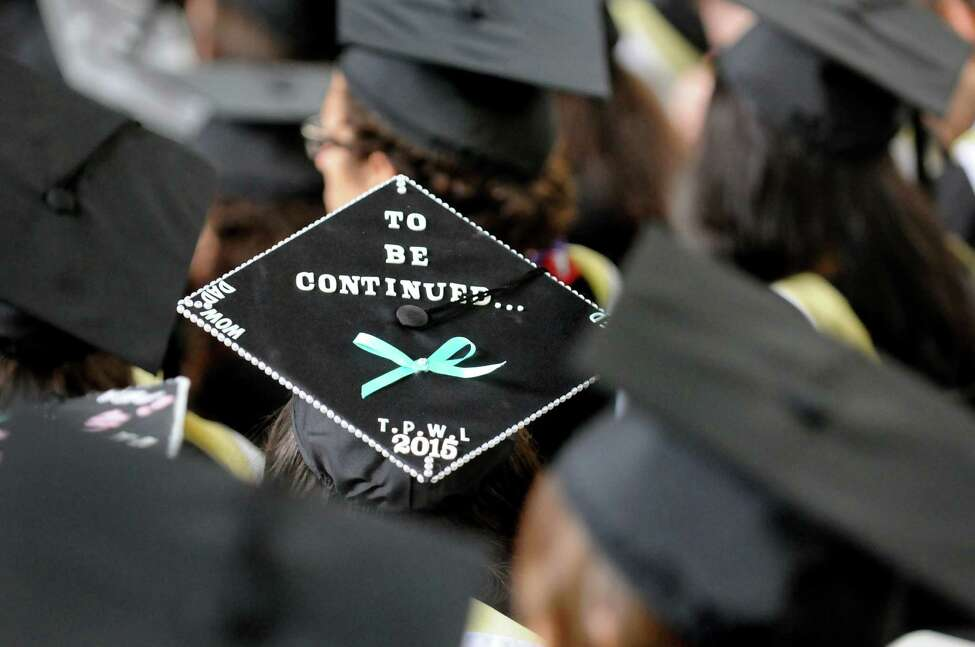 A graduate sends a message via her mortar board during Skidmore College commencement exercises on Saturday, May 16, 2015, at Saratoga Performing Arts Center in Saratoga Springs, N.Y. (Cindy Schultz / Times Union)