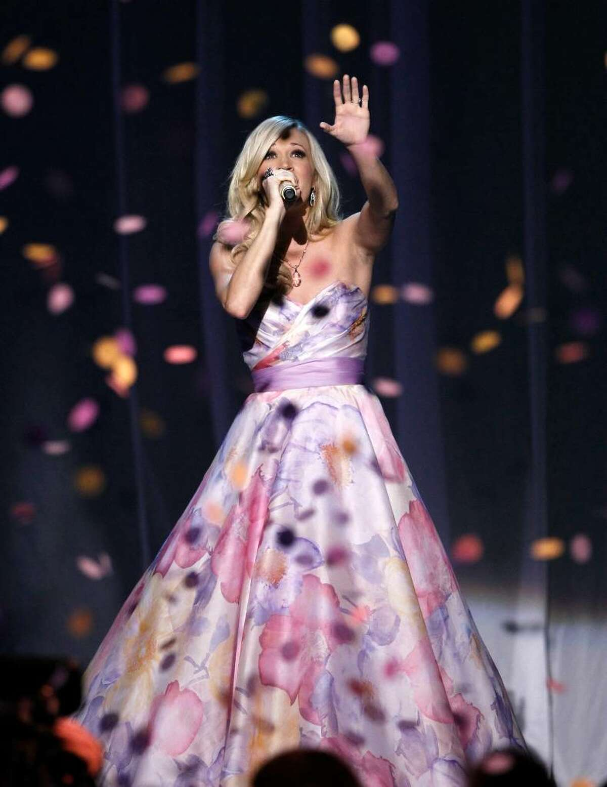 Carrie Underwood performs at the 45th Annual Academy of Country Music Awards in Las Vegas on Sunday, April 18, 2010. (AP Photo/Matt Sayles)