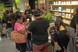 Customers file in at the grand opening of Simply Mac in Midland Park Mall Friday morning. Tim Fischer\Reporter-Telegram