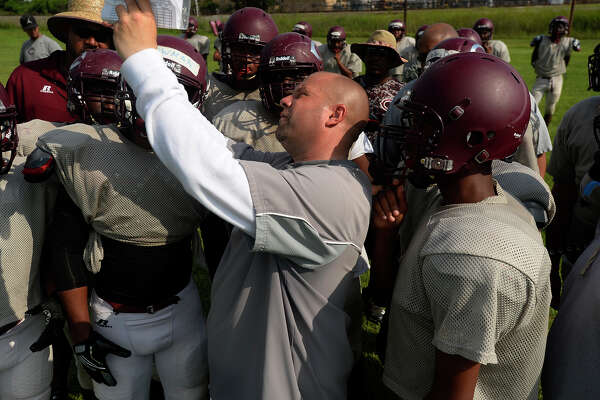 Central's head football coach Toby Foreman talks to players during spring football practice on Tuesday afternoon.  Photo taken Tuesday 5/10/16 Ryan Pelham/The Enterprise
