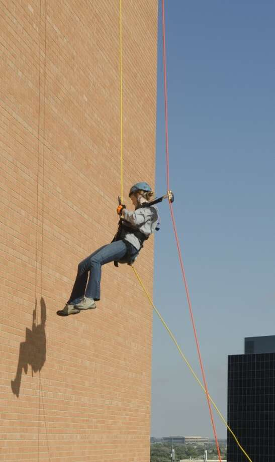 FILE PHOTO--- MARC will host its first Over the Edge fundraiser, which will give participants the chance to rappel from the downtown Community National Bank building. The event is scheduled for Oct. 5. Photo: Tim Fischer