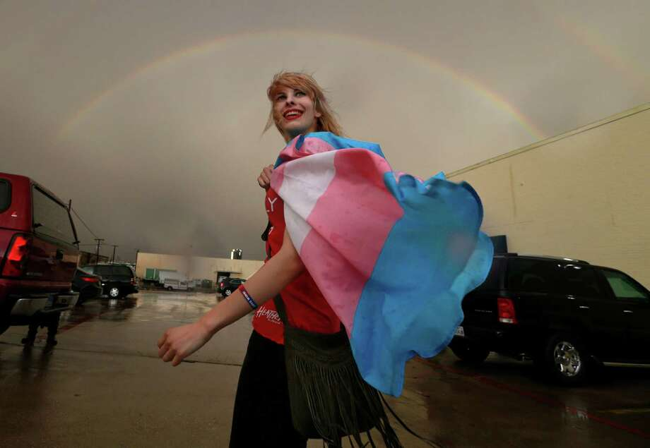 Following a public Fort Worth ISD meeting, at which transgender policies in schools were discussed, Alison Francis of Hurst smiles as a full rainbow appears over the board of education complex. Photo: Tom Fox, Staff Photographer / The Dallas Morning News