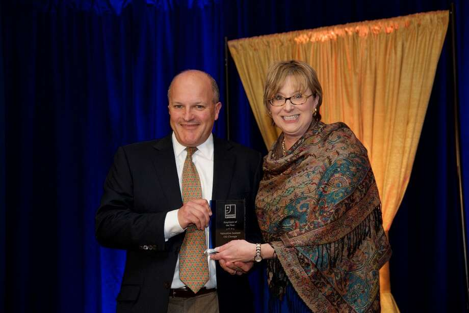 (L to R) co-owner of Valvoline Instant Oil Change, Paul John Ferri accepts the 2015 Goodwill Employers of the Year Award from Vickie Volpano, President and CEO of Goodwill of Western & Northern Connecticut at the Goodwill of Western & Northern Connecticut Annual Achievement Awards luncheon on April 28, 2016. Photo: /Contributed Photo