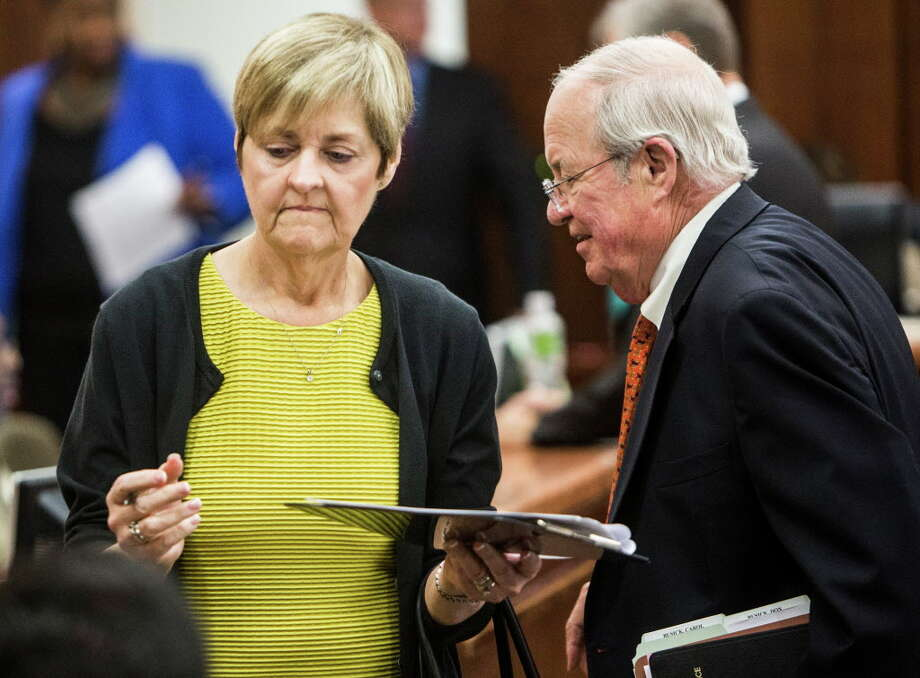 Dr. Carole Busick, Pd.D, stands with attorney Mike Hinton as she appears in court for sentencing on tampering with evidence on Wednesday, May 11, 2016, in Houston. The couple sentenced 10 years deferred adjudication for certifying psych evaluations for potential law enforcement officers, when in fact, the new hires had failed to meet professionally recognized standards. Photo: Brett Coomer, Houston Chronicle / © 2016 Houston Chronicle
