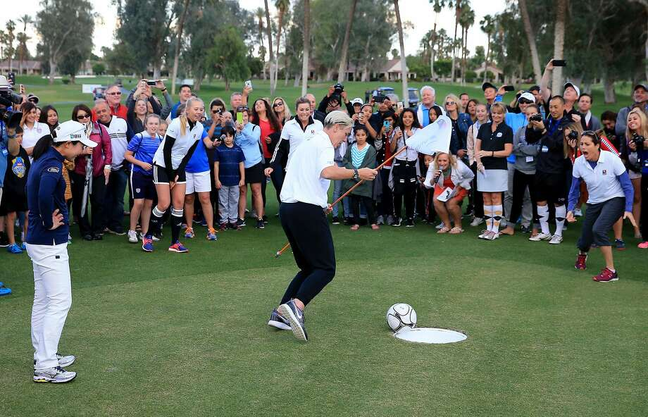 "Pro golfer Paula Creamer prepares to celebrate with ex-soccer star Abby Wambach as her ""foot putt"" goes into the hole and the other players, golfer Jessica Korda (left) and soccer's Julie Foudy (right) react during a Footgolf Faceoff. Photo: David Cannon, Getty Images"