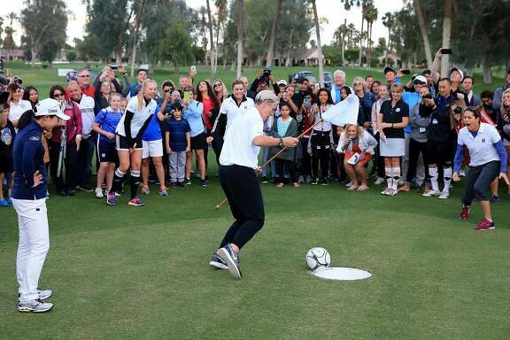 RANCHO MIRAGE, CA - MARCH 29:  Paula Creamer of the United States prepares to celebrate with Abby Wambach of the United States as her 'foot putt' goes into the hole and the other players Jessica Korda (l) and Julie Foudy (r) react during the ANA Footgolf Faceoff between Team USA and Team Japan as a preview for the ANA Inspiration at the Mission Hills Country Club on March 29, 2016 in Rancho Mirage, California.  (Photo by David Cannon/Getty Images)