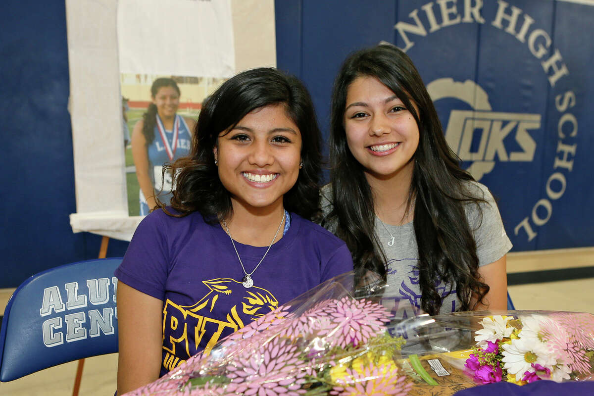 Lanier distance runners Jovana Espinosa (left) and Joanna Benavidez in the school's Aliumni Center after signing letters of intent to attend Prairie View A&M on track and cross country scholarships on Thursday, May 5, 2016. MARVIN PFEIFFER/ mpfeiffer@express-news.net