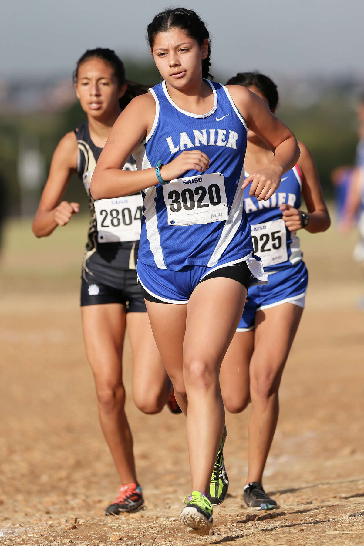 Lanier's JoAnna Benavidez leads teammate Jovana Espinoza (right) and Edison's Litzy Flores in the varsity girls 3 mile run during the District 28-5A cross country meet at San Antonio State Hospital on Friday, Oct. 16, 2015. Benavidez won the event with a time of 18:59.91. Flores finished second and Espinoza fourth. MARVIN PFEIFFER/ mpfeiffer@express-news.net